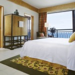 Deluxe Ocean View Suite Bed